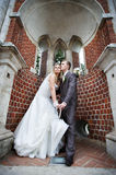 Happy bride and groom in a beautiful arch Stock Image