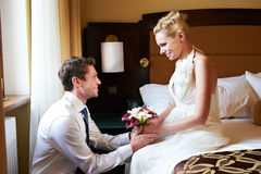 Happy bride and groom in bedroom Royalty Free Stock Photography
