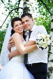 Happy bride and groom at the birches Royalty Free Stock Photo