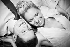 Happy bride and groom black and white. Happy bride and groom lying on bed black and white Stock Photo