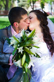 Happy bride and groom with bouquet Stock Photo