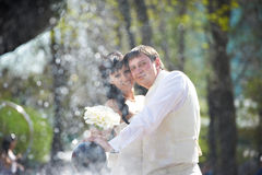 Happy bride and groom with bouquet Royalty Free Stock Image