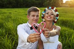 Happy bride and groom on the bright green field Stock Photo