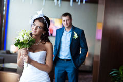 Happy bride and groom in a bright room Royalty Free Stock Image