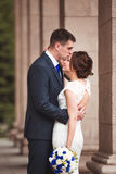 Happy bride and groom celebrating wedding day, kissing married couple Stock Photography