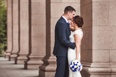 Happy bride and groom celebrating wedding day, kissing married couple Stock Image