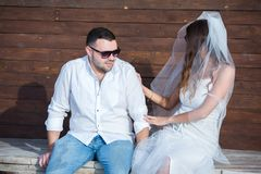 Happy bride and groom. Cheerful married couple. Just married couple embraced. Wedding couple stock photography