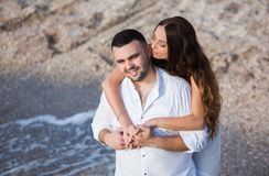 Happy bride and groom. Cheerful married couple. Just married couple embraced. Wedding couple stock images