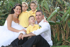 Happy bride groom and children. Shot of a happy bride groom and children royalty free stock photo