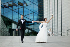 Happy bride and groom in a city Stock Images