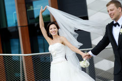 Happy bride and groom in a city Stock Photo