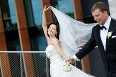 Happy bride and groom in a city Royalty Free Stock Image