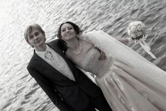 Happy bride and groom on the coast Royalty Free Stock Photo