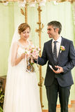 Happy bride and groom drinking champagne at registry office Royalty Free Stock Photography