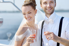 Happy bride and groom drinking champagne Royalty Free Stock Image