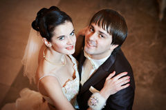 Happy bride and groom embraced Stock Photography