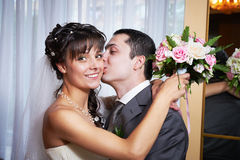 Happy bride and groom embraced Stock Image