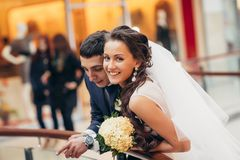 Happy bride and groom embracing in the shopping complex Royalty Free Stock Photos