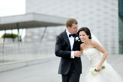 Bride and groom in a city Stock Photos