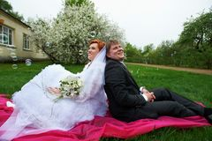 Happy bride and groom in garden Stock Photos
