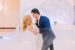 Happy bride and groom  gracefully dance. Wedding celebration.  Royalty Free Stock Photo