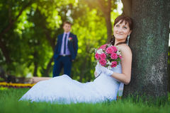Happy bride and groom in the green park Royalty Free Stock Photo
