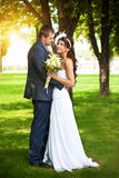 Happy bride and groom in a greenl summer park Royalty Free Stock Photos
