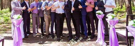 Happy bride and groom with guests. Happy bride and groom standing with guests Royalty Free Stock Photography