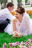 Happy bride and groom having fun Royalty Free Stock Photos