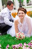 Happy bride and groom  having fun Royalty Free Stock Image