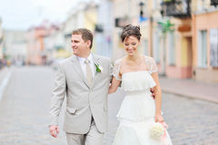 Happy bride and groom having fun in an old town Stock Photography