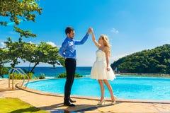 Happy bride and groom having fun on a tropical beach Royalty Free Stock Photos