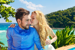 Happy bride and groom having fun on a tropical beach Stock Photos