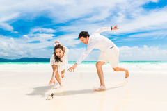 Happy Bride and Groom having fun on the tropical beach. Wedding Royalty Free Stock Image