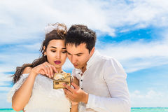 Happy Bride and Groom having fun on the tropical beach. Wedding Royalty Free Stock Photography