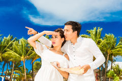 Happy Bride and Groom having fun on the tropical beach. Wedding Stock Photography