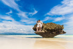 Happy Bride and Groom having fun on the tropical beach. Wedding Stock Images