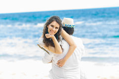 Happy Bride and Groom having fun on the tropical beach. Wedding. And honeymoon concept Stock Photography