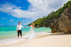 Happy Bride and Groom having fun on the tropical beach. Wedding. And honeymoon concept Royalty Free Stock Photography