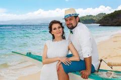 Happy bride and groom having fun on a tropical beach. Wedding an. D honeymoon on the tropical island Stock Photo