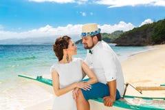 Happy bride and groom having fun on a tropical beach. Wedding an. D honeymoon on the tropical island Stock Photography
