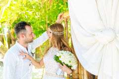 Happy bride and groom having fun on a tropical garden under the Stock Image