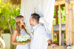 Happy bride and groom having fun on a tropical garden under the Stock Photography