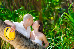 Happy bride and groom having fun on a tropical jungle Royalty Free Stock Images