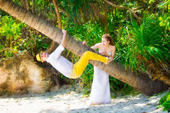 Happy bride and groom having fun on a tropical jungle Stock Image