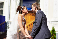 Happy bride and groom holding hands Stock Photos