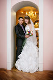 Happy bride and groom in the  hotel hall Royalty Free Stock Photo
