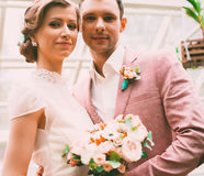 Happy bride and groom in hothouse Stock Photo