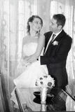 Happy bride and groom in the house. Black and white Stock Images