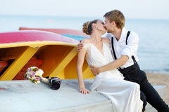 Happy bride and groom hugging by the sea Royalty Free Stock Images